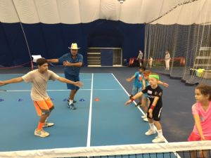 8 & under players with tournament director Tim Johnson